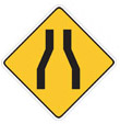 Roadway Narrows -  means that the road gets smaller in width. because of space or anything else. this is a warning to wide trucks